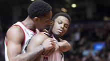 Toronto Raptors guard Kyle Lowry is hugged by Raptors guard DeMar DeRozan after Lowry made the game-winning basket to defeat the Cleveland Cavaliers on Friday. (Nathan Denette/THE CANADIAN PRESS)