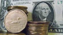 Canadian dollars shown with U.S dollars. (Ryan Remiorz/THE CANADIAN PRESS)