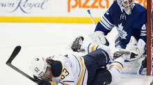 Buffalo Sabres' Tyler Ennis hits the ice during first period NHL action in Toronto (Frank Gunn/THE CANADIAN PRESS)