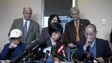 Amanda Zhao's parents speak to the media in 2008. The Zhaos are waiting anxiously for a verdict in the trial of Ms. Zhao's accused killer, Ang Li. (Laura Leyshon for The Globe and Mail)