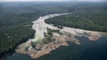 Contents from a tailings pond are pictured going down Hazeltine Creek into Quesnel Lake in B.C. on August 5, 2014. (Jonathan Hayward/The Canadian Press)