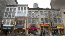 Developer David Blanchard wants to demolish the storefronts at 18 to 24 King St. East in Hamilton and replace them with new development. (Peter Power/The Globe and Mail)