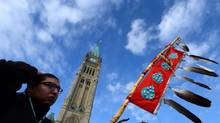 Assembly of First Nations Youth Council member Clayton Tootoosis takes part in a Assembly of First Nations rally on Parliament Hill in Ottawa on Tuesday, Dec. 10, 2013. (Sean Kilpatrick/THE CANADIAN PRESS)