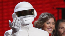 "Thomas Bangalter, of Daft Punk, accepts the award for record of the year for ""Get Lucky"" at the 56th annual Grammy Awards at Staples Center on Sunday, Jan. 26, 2014, in Los Angeles. (Matt Sayles/Matt Sayles/Invision/AP)"