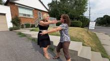 Realtor Rochelle DeClutecongratulates homeowner Sandra Davis after selling her Toronto home for $13,000 more than the asking price.  (Deborah Baic/The Globe and Mail staff)