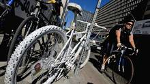 Dozens of cyclists gathered at a memorial to Darcy Sheppard on Tuesday, after the Crown dropped charges against Michael Bryant. (Peter Power/Peter Power/The Globe and Mail)
