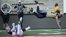 Winnipeg Blue Bombers wide receiver Julian Feoli-Gudino flies over Montreal Alouettes defensive back Jamaan Webb during first quarter CFL football action Friday, July 11, 2014 in Montreal. (Paul Chiasson/THE CANADIAN PRESS)