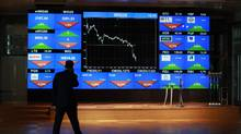 A man looks at the index screen at the Warsaw Stock Exchange in Warsaw August 10, 2011. (Kacper Pempel/Reuters/Kacper Pempel/Reuters)