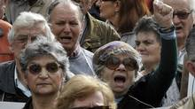 Greek pensioners demonstrate Wednesday in Athens against the government's proposed austerity measures. (LOUISA GOULIAMAKI)