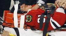 Chicago Blackhawks' Marian Hossa is taken off the ice on a stretcher after being injured following a check by Phoenix Coyotes' Raffi Torres during Game 3 of their NHL Western Conference quarter-final playoff hockey game in Chicago, Illinois April 17, 2012. REUTERS/Jim Young (JIM YOUNG)