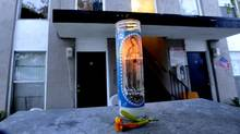 A memorial candle sits outside the Buena Park, Calif., apartment complex on Aug. 19 where the body of a model from Los Angeles, Jasmine Fiore, 28, was placed in a dumpster. (Bruce Chambers)
