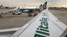 Italy's flagship carrier, Alitalia, said it was cancelling some 40 per cent of its domestic and international flights March 20 due to strikes by air traffic controllers and air transport workers. (Luca Bruno/AP)