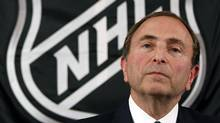 FILE - In this Sept. 13, 2012, file photo, NHL hockey commissioner Gary Bettman listens as he meets with reporters after a meeting with team owners, in New York. (Associated Press)