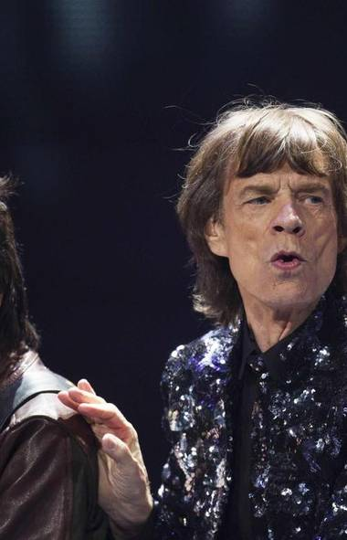 Rolling Stone frontman Mick Jagger rocks some awesome girl bangs in New York on Saturday. At least he isn't making out with Kirk Douglas. (Reuters)