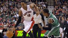 'To the rim' face: DeMar DeRozan drives past Boston Celtics guard Rajon Rondo during the second half of their NBA basketball game in Toronto April 13, 2012. (Reuters)