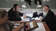 Ultra-Orthodox Jews work in the trading room of Israel's. near Tel Aviv on Oct. 30, 2012. The country has one of the world's hottest diamond exchanges, but polishers and cutters of the precious stones have been replaced by cheaper workers in newer hubs such as India and China. (NIR ELIAS/REUTERS)