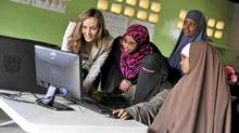 On left is Amanda Lindhout. In 2012 the GEF opened the Rajo Women's Literacy School, providing education and job skills training to 75 female Somali refugees living in Eastleigh, Keny (Riccardo Gangale/Riccardo Gangale)