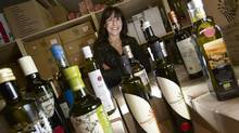 Elena Lepori of Lugano Fine Foods is photographed with various bottles of olive oil in Toronto, Wednesday, January 30, 2013. (Kevin Van Paassen/The Globe and Mail)
