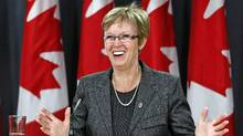 Nycole Turmel is all smiles as an Ottawa news conference wrapping up her term as Interim NDP Leader on March 21, 2012. (CHRIS WATTIE/Chris Wattie/Rueters)