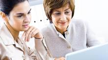 Businesswomen with laptop (nyul/Getty Images/iStockphoto)
