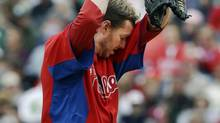 Philadelphia Phillies starter Roy Halladay reacts Tuesday after allowing a two-run homer to Don Kelly of the Detroit Tigers. (Kathy Willens/The Associated Press)