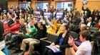 Supporters cheer during a meeting when the Seattle City Council voted to approve a measure that would allow ride sharing drivers for Uber and Lyft to unionize in Seattle, Washington, December 14, 2015.