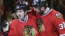 Chicago Blackhawks center Dave Bolland, left, celebrates his second-period goal with defenseman John Scott (32) in Game 4 of an NHL hockey Stanley Cup playoffs first-round series Tuesday, April 19, 2011, in Chicago. (AP Photo/Nam Y. Huh) (Nam Y. Huh/AP)