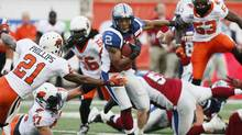 Montreal Alouettes' Brandon Whitaker (2) runs for a touchdown against the BC Lions during first half CFL football action in Montreal, July 4, 2014. (CHRISTINNE MUSCHI/REUTERS)