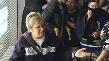 Who is this woman? Help us identify who confronted a crowd in front of the Holt Renfew on Granville Street in Vancouver. The windows were smashed during rioting after the Canucks' 4-0 loss to Boston in game 7 of the Stanley Cup championship. (Dave Lang photo)