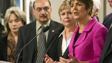 NDP MLA Raj Chouhan, left, with colleagues Dawn Black and Carole James in Vancouver. He has committed to reimbursing the province for the cost of his wife's plane fare to South Africa. (RICHARD LAM/THE CANADIAN PRESS)