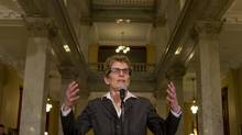 The new Liberal leader and Ontario Premier Kathleen Wynne heads to the microphone to speak to the media before her first caucus meeting at Queen's Park on Jan. 29, 2013. (Peter Power/Peter Power/The Globe and Mail)