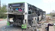 A picture taken on April 16, 2017, shows the damage a day after a suicide car bombing attack in Rashidin, west of Aleppo, targeted buses carrying Syrians evacuated from two besieged government-held towns of Fuaa and Kafraya. (OMAR HAJ KADOUR/AFP/Getty Images)