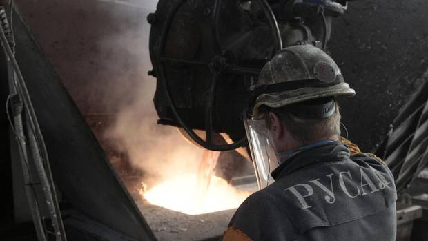 A worker operates a mixer of fused aluminum at the foundry shop of the Rusal Krasnoyarsk aluminum smelter in the Siberian city of Krasnoyarsk Aug. 14, 2012. The smelter produces about 1 million tons of aluminum a year and accounts for 3 per cent of global output. (ILYA NAYMUSHIN/REUTERS)