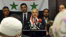 Syrian opposition figure Samir Nashar (C) addresses a meeting in Istanbul October 2, 2011. (REUTERS/STRINGER/TURKEY/REUTERS/STRINGER/TURKEY)