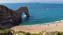 The Durdle Door, a natural limestone arch, is one of the most dramatic landmarks along the Dorset coast. (Amy Laughinghouse)