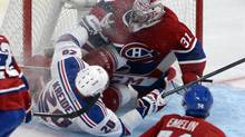 New York Rangers forward Chris Kreider (20) collides with Montreal Canadiens goalie Carey Price (31) during the second period in Game 1 of the Eastern Conference Finals of the 2014 Stanley Cup Playoffs at the Bell Centre on May 17. (Eric Bolte/USA Today Sports)
