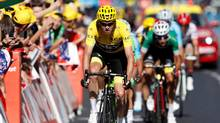 Team Sky rider and yellow jersey Chris Froome of Britain near the finish line. (CHRISTIAN HARTMANN/REUTERS)
