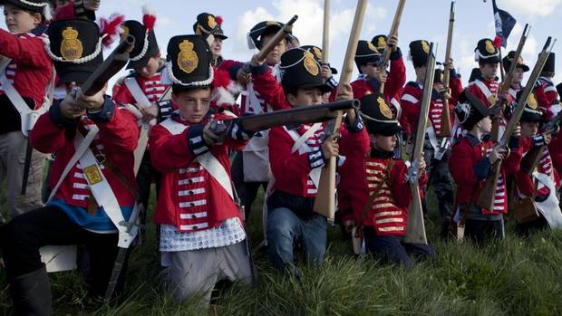 Scouts fire towards the Americans during a reenactment of the War of 1812 by Scouts Canada and Boy Scouts of America at Fort George in Niagara-on-the-Lake, ON, on Sunday September 23, 2012. (Matthew Sherwood for The Globe and Mail)