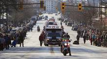 The funeral procession for North Shore Rescue leader Tim Jones makes its way down Lonsdale Ave in North Vancouver, British Columbia on January 25, 2013. (Ben Nelms for The Globe and Mail)