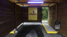 A poster recommending the use of condoms is pictured inside an illuminated so-called 'sex box' during a media preview at a sex drive-in west of Zurich. After passing a check-in gate drivers, who must be alone in their vehicles, follow a marked route, negotiate a rate with one of the 40 prostitutes stationed there and drive on to one of nine partially enclosed wooden booths to have sex. (ARND WIEGMANN/REUTERS)