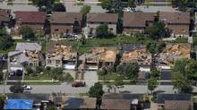Damaged homes in Vaughan, Ont., on Aug. 21 after a tornado touched down in the neighbourhood north of Toronto on Thursday night. (Darren Calabrese)