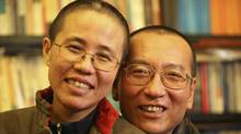 Chinese dissident Liu Xiaobo and his wife, Liu Xia, pose in this undated photo released by his family on Oct. 3, 2010. (HO)