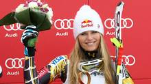 Lindsey Vonn, of the United States, celebrates on the podium her third place after completing a women's World Cup downhill on the Sochi Olympics course, in Krasnaya Polyana, near Sochi, Russia, Saturday, Feb.18, 2012. Vonn clinched her fifth consecutive World Cup downhill title Saturday, although German rival and friend Maria Hoefl-Riesch won the race on the 2014 Sochi Olympics course. (Alessandro Trovati/AP)