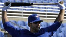 Toronto Blue Jays batter Jose Bautista stretches during batting practice at their MLB American League spring training facility in Dunedin, Florida February 20, 2012. REUTERS/Mike Cassese (Mike Cassese/Reuters)