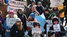 Demonstrators rally at police headquarters in St. John's on Feb. 27, 2017 following a weekend of outrage after a Newfoundland officer was acquitted of sexual assault. (Paul Daly/THE CANADIAN PRESS)