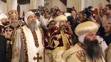 Coptic Pope Tawadros II, second from left, head of the Coptic Orthodox church, as he arrives to celebrate Easter mass at Cairo's main cathedral on May 4, 2013. (ASMAA WAGUIH/REUTERS)