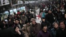 Shoppers flock to Shanghai streets (Eugene Hoshiko/Eugene Hoshiko/Associated Press)