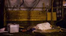 A homeless woman sleeps at a tent city at Oppenheimer Park in the Downtown Eastside of Vancouver, October 15, 2014. (DARRYL DYCK/THE CANADIAN PRESS)