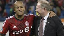 Toronto FC's Robert Earnshaw is congratulated by president and general manager Kevin Payne after scoring both goals in his team's 2-1 win over Sporting Kansas City in MLS action in Toronto on Saturday March 9, 2013. (Chris Young/THE CANADIAN PRESS)
