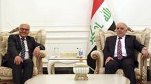 Iraq's Prime Minister-designate Haider al-Abadi (R) meets with German's Foreign Minister Frank-Walter Steinmeier in Baghdad Aug. 16. (POOL/REUTERS)